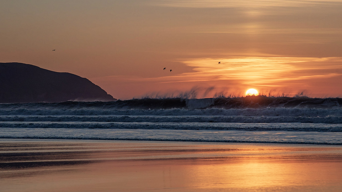 Beautiful sunset on Woolacombe beach - one of the best surfing locations in North Devon