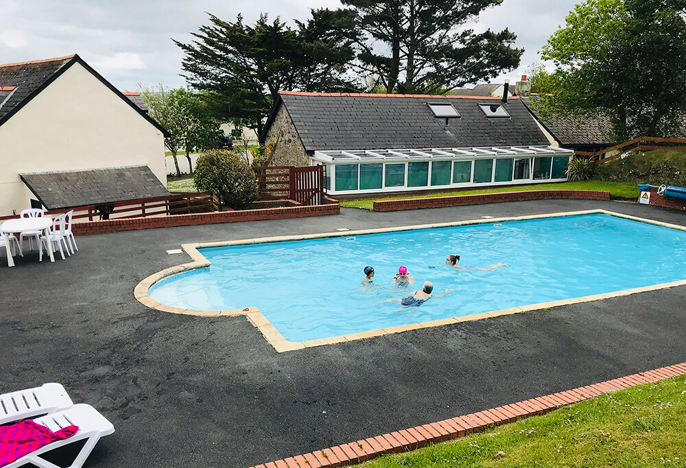 People enjoying the swimming pool on their holiday at Willingcott Valley, woolacombe